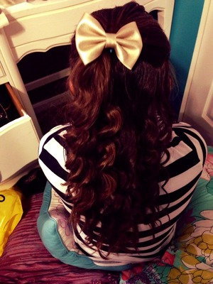 Here Is a picture of my hair a couple weeks ago that I posted (: If your wondering where I got the bow, I got it for $2.80 at Forever 21. I also used the Conair curling wand, and I am not sure at the moment where that is from (: