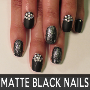 I played around with some glitter, rhinestones, and a matte topcoat, and got this! Blog post with video tutorial here: http://offbeatlook.com/matte-black-nail-design-tutorial