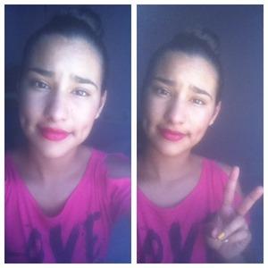 Red lipstick and a high bun <3