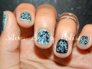Mint and navy manicure created using dry marbling.