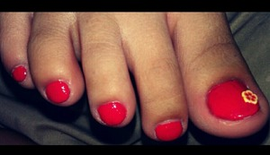 tangerine orange toes with flower fimo accent!! :)