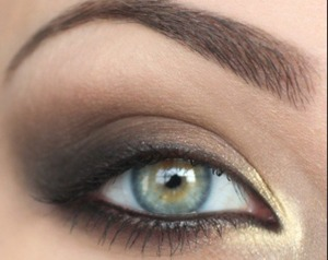 This is so cute. I love how the gold brings out the eye with a pop of color.