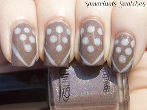 Glitter Gal Dots & Stripes  http://samariums-swatches.blogspot.com/2011/12/glitter-gal-light-as-feather-suede.html