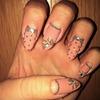 Edgy Bow Nail Design
