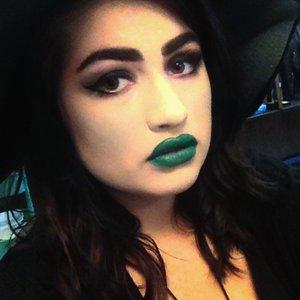 green lip, green blush, smokey eye