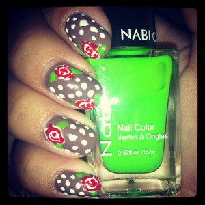 taupe nails with red roses and white polkadots!! :)