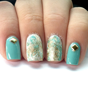 A very elegant manicure using white, gold and blue polish to make a jaw dropping manicure. I also threw some studs to finish it off :)