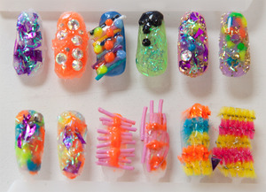 Our first attempt at gel/3D nail art nails! I did the top row, Malcolm Stuart did the bottom.