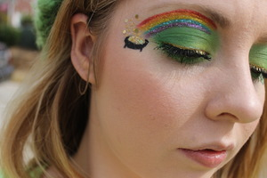 I can't tag these specific products used because it doesn't give the the selection. So for the rainbow I used costal scents 88 color eye shadow palette I used a few colors from the palette to create the base for the rainbow and I used the green from the palette on my eyelids. Then I took beauty from the earth pigments ( top to bottom) addicted, tangerine, lemon, blueberry and grape. Packed those pigments on the lines I have already created so the rainbow would appear more vivid in color. Then took eyelash glue to every line and applied Martha Stewart fine glitter (top to bottom) carnelian, fire opal, yellow barite, turquoise and charoite. Used a black liquid liner to create the pot then filled it in with the urban decay eldorado then packed some gold glitter in florentine gold (Martha Stewart)  on top with eyelash glue. And for the glitter chunks it's florentine gold in chunck form by Martha Stewart.
