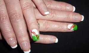 These are my mums nails. I did her nails for the Rugby! This design is Welsh Flag inspired and I used a red nail art brush, a white nail polish for the french tips and the ring finger and I sponged on the green for a grass like gradient effect/ Hope you like them! x
