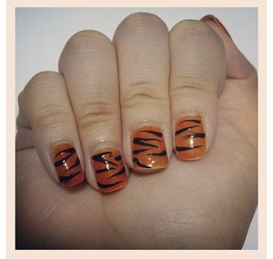 I was trying out tiger stripes nail art and I like this design. I have a video on how I did it (: