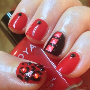 I felt like a bitchin' red manicure and I'm still on a leopard and stud kick (thanks to Modnails), so here's some accented nails with rhinestones (from eBay) and studs (from dollarnailart.com).  I used Zoya Sooki & Glitter Gal Serpent Black  http://michtymaxx.blogspot.com.au/2013/02/red-studded-animal-nails.html