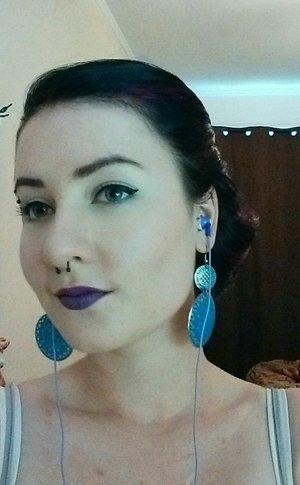 MAC Heroine lip colour, MAC black liquid liner, and a simple side bun :)
