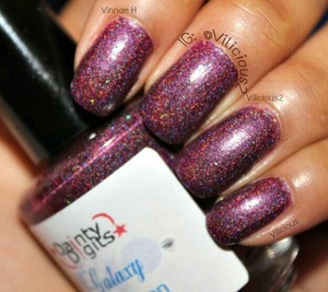 Two coats of Dainty Digits Mercury Sunrise without topcoat. A burgundy holographic.