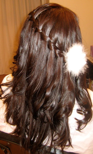 This is a wrap around waterfall french braid.  The curls were created with a one inch flat iron.