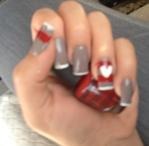 A grey white manicure and a heart