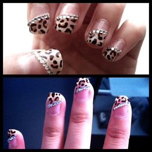 Leopard print diagonal french tips with rhinestone bordering