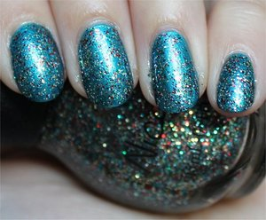 See more swatches & my review here: http://www.swatchandlearn.com/nicole-by-opi-kardashing-through-the-snow-swatches-review-layered-over-nicole-by-opi-deck-the-dolls/