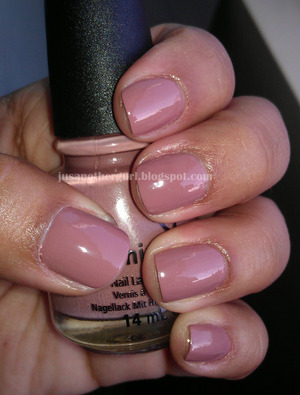 Pretty dusty pink rose color.