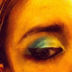 Colorful Smokey Eye using yellow and blue shadows from Urban Decay's The Vice Palette, along with liquid eye liner to make a cateye.