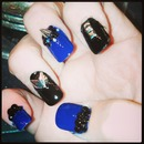 blue and black studded and spiked