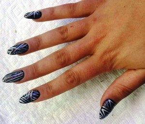 Not my nails, but my daughter's - she likes to have them black, with a random, different design on each nail. And the undersides are red.
