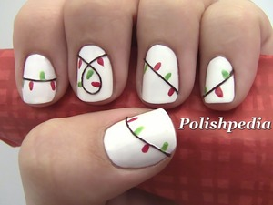 Instead of putting up lights on your home do it on your nails!  Watch The Video Tutorial @ http://www.polishpedia.com/christmas-lights-nail-art.html