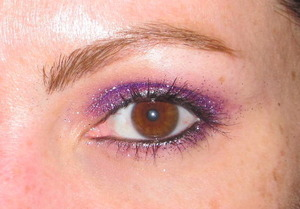 This is purple Haze by MyFace Cosmetics with Cailyn purple glitter on top. Stila black Kajal eyeliner on my waterline and 2 coats of Physicians Formula Shimmer Strips mascara for brown eyes (purple).