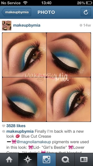 White shimmering eyeshadow with a ray of blue sparkle in the crease of the eye to add that pop effect thatll make your eyes stand out from all the rest.
