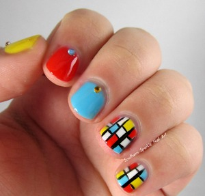 Check out this blog post if you want to recreate this look! :) http://www.southernsparklenailart.blogspot.com/2013/12/nail-art-inspired-by-mondrian.html