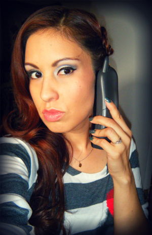The Maybelline eye tattoo is in white, I love it very much especially with silver like I wore today. Lip butter is in Peach Parfait, the only nude color I really love on me. Here I was on the phone with my Sis :)