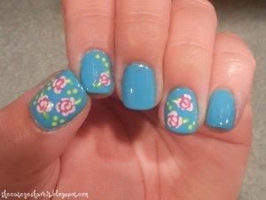 http://thecateyeshaveit.blogspot.com/2012/06/bright-roses-mani.html