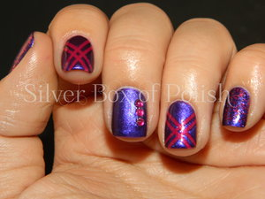 Pink and purple nails created with striping tape, rhinestones, and glitter.