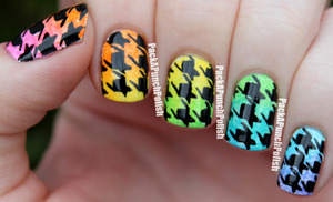 I learned how to do houndstooth print from Chelsea at Get Nailed! http://chelseasgetnailed.com  The gradient and print was done using acrylic paint.  Blog Post: http://packapunchpolish.blogspot.com/2012/10/gradient-houndstooth-nails.html