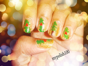 perfect gold party nails http://mypolish100.blogspot.in/2013/01/mistletoe-nails.html