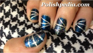 A fun design that includes both glitter and striping tape!  Check out the tutorial @ http://polishpedia.com/metallic-striping-tape-nails-tutorial.html