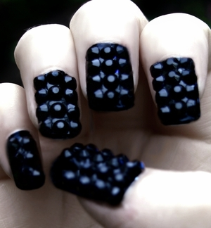 These are my Blackberry Nails! (TUTORIAL HERE: http://www.beautylish.com/v/rurwnm/blackberry-nails-glitterface-tutorial) I used 5mm rhinestones (plain black) on a base of black nail polish to create this look. Everyone keeps saying they look like blackberries which I guess it's fitting since Autumn is fast approaching! But these nails are literally the most twinkling nails I've ever had, they glitter from a mile away. Perfect for Glitterface when we're gigging with Nanu Nanu, the stage lights make them go crazy!  GFx