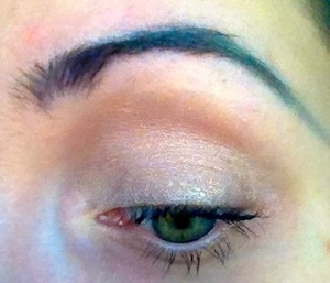Making a very simple eye look more interesting with purple and teal multi-colored eyebrows...