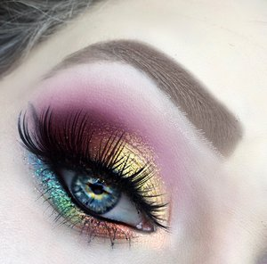 """Here is a close up of the eye makeup :)! I find """"mind"""" to be the most important stone of all so I made sure it really popped on the lid (the bright yellow).  Be sure to view my blog post featuring sneak peaks of the video tutorial coming out in a few hours!  http://theyeballqueen.blogspot.com/2016/03/marvels-infinity-stones-glittery.html"""