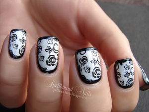 http://spellboundnails.blogspot.com/2012/10/elegant-border-nails.html