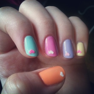 essie mint candy apple , sally hansen extreme  weae bublegum pink and lacey lilac, rimmel tangy tangerine amd lemon drop+ nail sticker