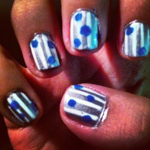 SILVER POLISH WITH WHITE STRIPES AND BLUE DOTS