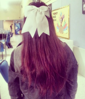 red hair, top pulled pack with bow