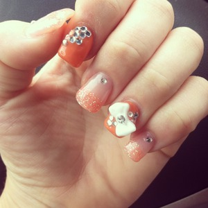 Fun summery nails with glitter, bows and bling to top it all of for some summer fun