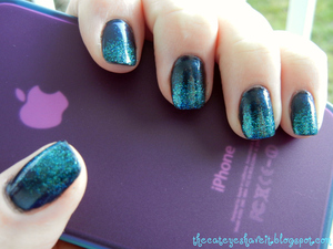 http://thecateyeshaveit.blogspot.com/2012/01/christys-mani-with-essie-dive-bar.html