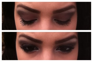 Brown and black smokey eye with white inner corners and bold black lashes.