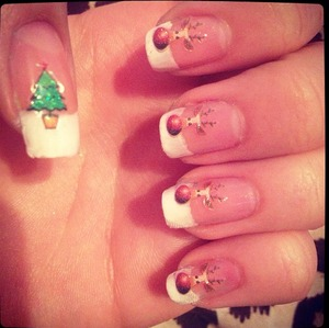 Getting in the spirit!  White tipped nails with Christmas design stickers.