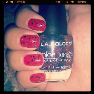red nails with a fun confetti glitter over them! :)