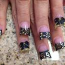 gold swag and 3D bows nails.