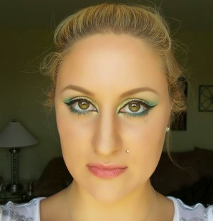 Turquoise and gold cut crease using elf geometric palette and Sephora cream eyeliner in black. For brows I used Anastasia dipbrow in blonde and brow wiz in soft brown. Foundation is Mac Studio fix.